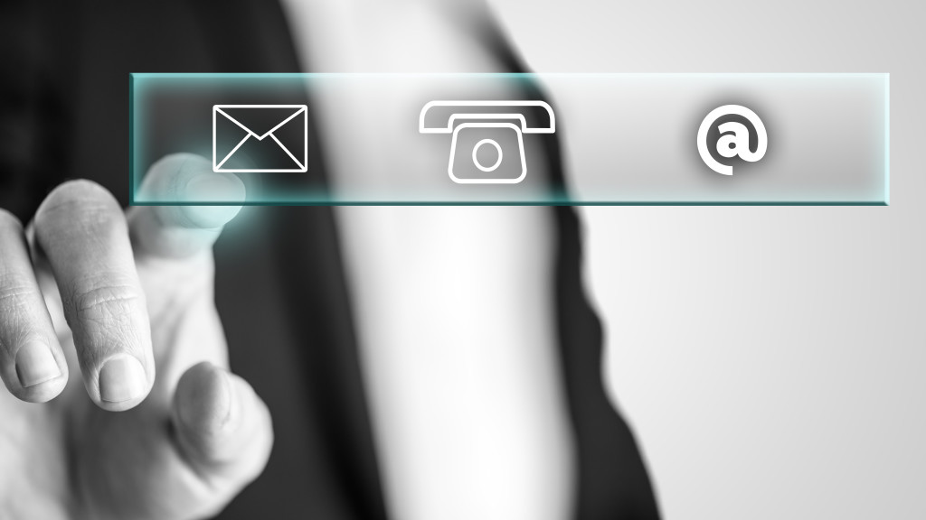 Male hand pressing with the finger on mail icon